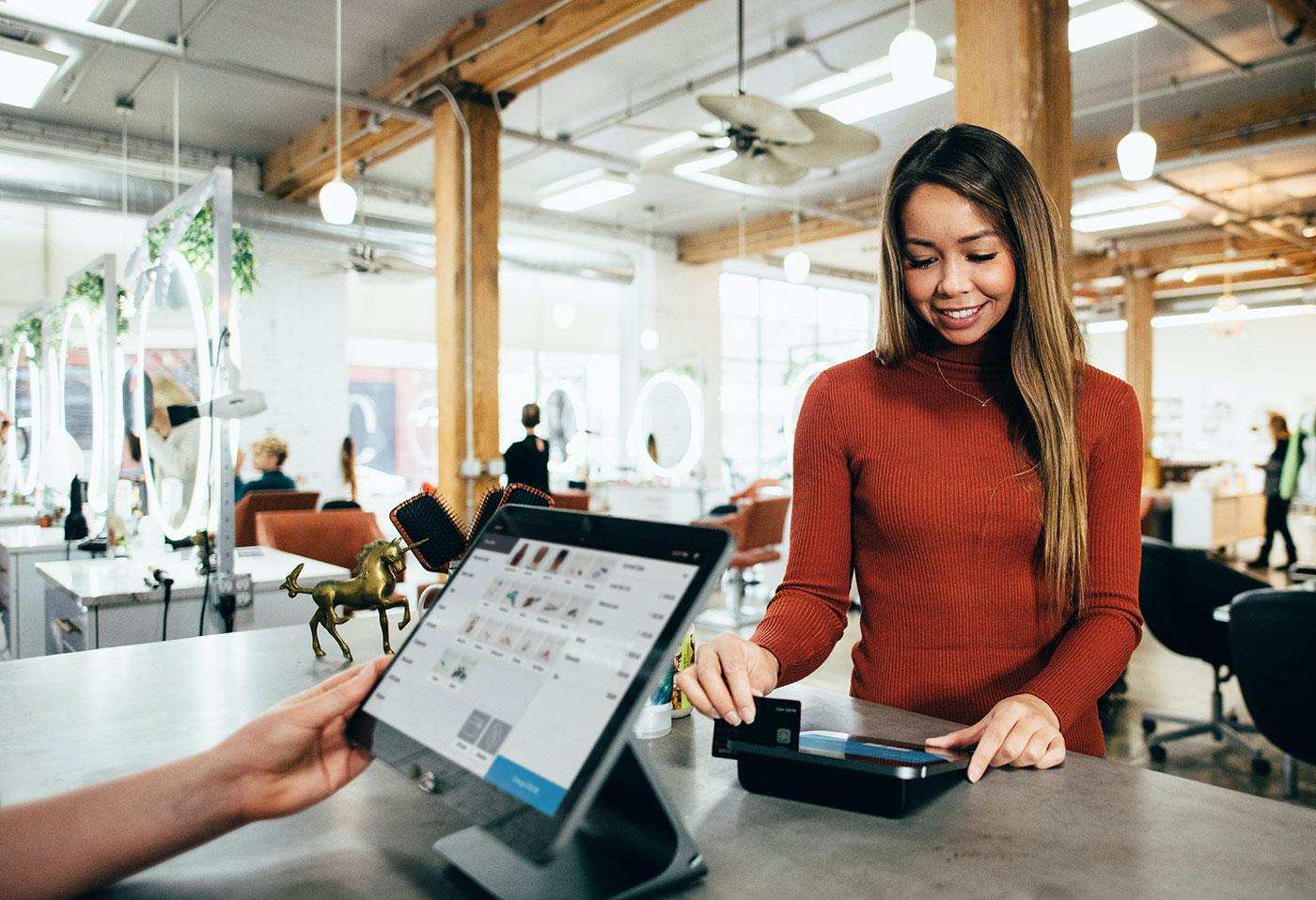 Woman using payment terminal